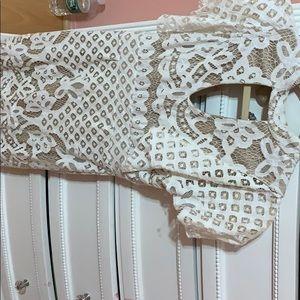 A white short lace dress